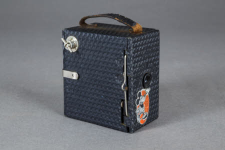 An Ensign Mickey Mouse box camera by Houghton-Butcher.