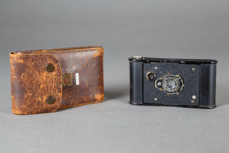 A Kodak Vest Pocket miniature camera in a leather case.