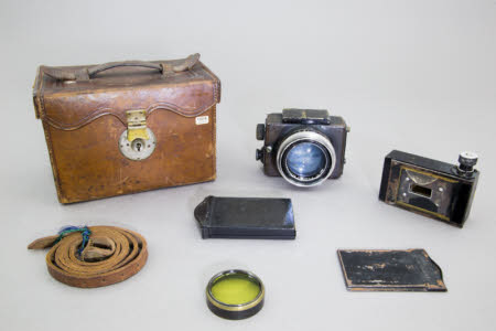 Ermanox miniature camera in tan leather box case.