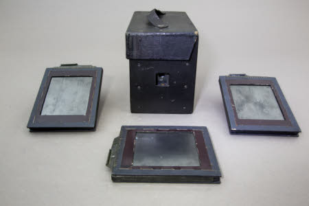 A Griffiths Guinea Detective camera with integrated carrying case and three photographic plate ...