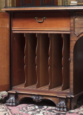Interior of one of the pedestals to the library table, showing upright, shaped folio divisions of mahogany and oak © National Trust Images / John Hammond