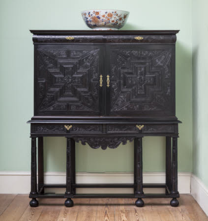 Osterley Park's 'Elaborately carved Ebony cabinet on carved pillar Stand' - circa 1630
