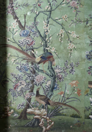 Bird-and-flower wallpaper on a green ground