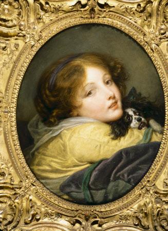 A Girl holding a Spaniel