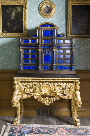 'A very curious blue cabinet of Lapis Lazuli on a wrought gilt frame'